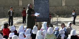 Afghan school children attend class with the support of the United Nations Children's Fund,